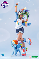 Size: 1200x1799 | Tagged: safe, kotobukiya, rainbow dash, human, pegasus, pony, clothes, dark skin, denim shorts, figurine, goggles, goggles on head, human ponidox, humanized, jean shorts, legs, merchandise, moe, one eye closed, pose, raised hoof, self ponidox, sexy, shorts, smiling, spread wings, sultry pose, tanktop, tomboy, wings, wink, winking at you