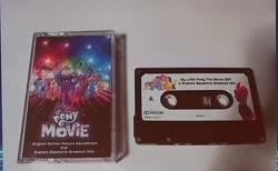 Size: 592x365 | Tagged: safe, applejack, fluttershy, pinkie pie, rainbow dash, rarity, spike, tempest shadow, twilight sparkle, alicorn, dragon, earth pony, pegasus, pony, unicorn, my little pony: the movie, bootleg, cassette, cassette tape, cowboy hat, female, galacon 2019, hat, male, mane seven, mane six, mare, original soundtrack, photo, twilight sparkle (alicorn)