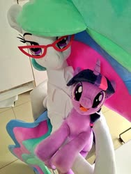 Size: 768x1024 | Tagged: safe, artist:nekokevin, princess celestia, twilight sparkle, alicorn, pony, unicorn, chair, clothes, duo, female, glasses, irl, lidded eyes, looking at you, mare, open mouth, photo, plushie, shirt, sitting, size difference, smiling, teacher and student, unicorn twilight