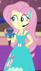 Size: 338x587 | Tagged: safe, screencap, fluttershy, best in show: the victory lap, equestria girls, equestria girls series, spoiler:eqg series (season 2), cropped, microphone, smiling, solo