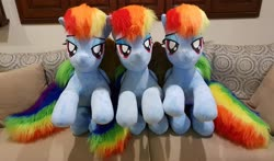 Size: 2788x1639 | Tagged: safe, artist:ponimalion, rainbow dash, pegasus, pony, bed, dashstorm, female, folded wings, irl, lifesize plush, mare, multeity, photo, plushie, rainbow dash is excited, self ponidox, triality, wings