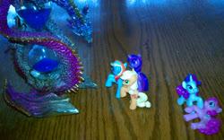 Size: 2736x1708 | Tagged: safe, applejack, pinkie pie, rainbow dash, rarity, twilight sparkle, dragon, pony, unicorn, blind bag, fight, hourglass, injured, merchandise, photo, rpg, toy, unicorn twilight