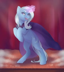 Size: 1024x1159 | Tagged: safe, artist:nekotoko, trixie, pony, unicorn, bipedal, cape, clothes, ear fluff, female, glowing horn, hooves to the chest, horn, magic, mare, open mouth, rearing, smiling, solo, stage, trixie's cape