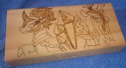 Size: 773x422   Tagged: safe, artist:dawn-designs-art, artist:sapphire-burns-art, king sombra, queen chrysalis, changeling, changeling queen, pony, unicorn, crystal, female, photo, pyrography, traditional art, wood