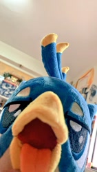 Size: 576x1024   Tagged: safe, artist:nekokevin, gallus, griffon, beak, birb, close-up, irl, lidded eyes, looking at you, male, maw, mawshot, open mouth, photo, plushie, solo, teenager, tongue out