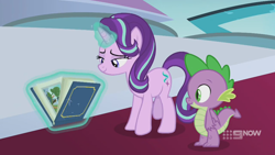 Size: 1280x720 | Tagged: safe, screencap, spike, starlight glimmer, dragon, pony, unicorn, spoiler:memories and more, spoiler:mlp friendship is forever, 9now, book, levitation, magic, magic aura, memories and more, scrapbook, telekinesis, winged spike
