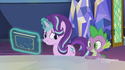 Size: 1280x720 | Tagged: safe, screencap, spike, starlight glimmer, dragon, pony, unicorn, spoiler:memories and more, spoiler:mlp friendship is forever, 9now, book, duo, levitation, magic, magic aura, memories and more, scrapbook, smiling, telekinesis, winged spike, worried, worried smile