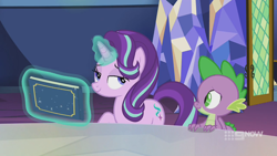 Size: 1280x720 | Tagged: safe, screencap, spike, starlight glimmer, dragon, pony, unicorn, spoiler:memories and more, spoiler:mlp friendship is forever, 9now, bedroom eyes, book, duo, levitation, magic, magic aura, memories and more, mid-blink screencap, scrapbook, smiling, smug, telekinesis, winged spike