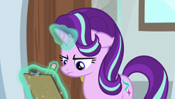 Size: 1920x1080 | Tagged: safe, screencap, starlight glimmer, pony, unicorn, a horse shoe-in, clipboard, female, frown, glowing horn, horn, magic, mare, pencil, solo, telekinesis, writing