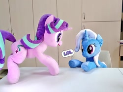 Size: 1024x768 | Tagged: safe, artist:nekokevin, starlight glimmer, trixie, pony, unicorn, series:nekokevin's glimmy, duo, female, happy, irl, lol, looking down, mare, open mouth, photo, plushie, raised hoof, sitting, smiling, underhoof