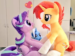 Size: 1024x768 | Tagged: safe, artist:nekokevin, starlight glimmer, sunburst, trixie, pony, unicorn, series:nekokevin's glimmy, cute, eye contact, female, floating heart, glimmerbetes, happy, heart, irl, looking at each other, male, mare, open mouth, photo, plushie, shipping, sitting, smiling, socks (coat marking), stallion, starburst, straight, trio, underhoof