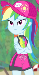 Size: 382x741 | Tagged: safe, screencap, pinkie pie, rainbow dash, equestria girls, equestria girls series, forgotten friendship, beach umbrella, blurred background, board shorts, cap, clothes, cloud, cropped, crossed arms, cute, dashabetes, female, forest background, geode of super speed, hat, jewelry, legs, lidded eyes, magical geodes, midriff, necklace, outdoors, rainbow, rainbow dash is not amused, shorts, sleeveless, solo focus, sun, swimsuit, thighs, thunderbolt, unamused