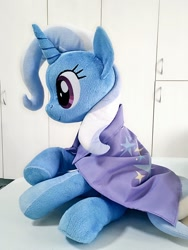 Size: 768x1024 | Tagged: safe, artist:nekokevin, trixie, pony, unicorn, cape, clothes, female, irl, mare, photo, plushie, sitting, smiling, solo, trixie's cape, underhoof