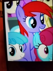Size: 4032x3024 | Tagged: safe, screencap, lightning bolt, white lightning, pegasus, pony, the washouts (episode), background pony, cropped, female, mare, photo, picture of a screen, smiling, unnamed character, unnamed pony