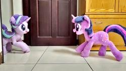 Size: 1024x576 | Tagged: safe, artist:nekokevin, starlight glimmer, twilight sparkle, pony, unicorn, series:nekokevin's glimmy, duo, female, irl, looking at each other, mare, open mouth, photo, plushie, raised hoof, raised leg, smiling, unicorn twilight