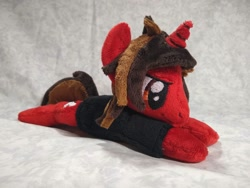 Size: 1032x774 | Tagged: safe, artist:bluedragonflyplush, pony, unicorn, all time low, beanie (plushie), clothes, commission, horn, irl, jack barakat, male, photo, plushie, ponified, prone, shirt, smiling, smirk, solo, stallion, t-shirt