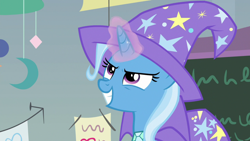 Size: 1920x1080 | Tagged: safe, screencap, trixie, pony, unicorn, a horse shoe-in, cape, clothes, female, grin, hat, magic, magic aura, mare, smiling, solo, trixie's cape, trixie's hat