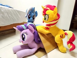 Size: 1024x768 | Tagged: safe, artist:nekokevin, starlight glimmer, sunset shimmer, trixie, pony, unicorn, series:nekokevin's glimmy, bipedal, box, female, irl, lying down, magical trio, mare, open mouth, photo, plushie, smiling