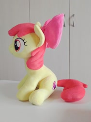 Size: 768x1024 | Tagged: safe, artist:nekokevin, apple bloom, earth pony, pony, bow, female, filly, hair bow, irl, photo, plushie, side view, sitting, smiling, solo