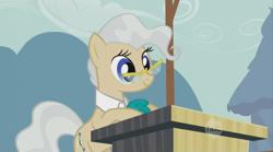 Size: 864x481   Tagged: safe, screencap, mayor mare, earth pony, pony, the last roundup, female, glasses, mare, podium, solo