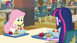 Size: 1904x1064 | Tagged: safe, screencap, fluttershy, twilight sparkle, equestria girls, equestria girls (movie), apple, bowl, burger, cafeteria, canterlot high, chair, food, fruit, glass, hamburger, plate, spoon, table