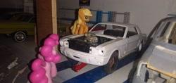 Size: 3264x1546 | Tagged: safe, applejack, pinkie pie, blind bag, car jack, chevrolet impala, dodge van, everfree customs, ford mustang, garage, shelf, toy, workbench