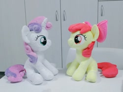 Size: 1024x768 | Tagged: safe, artist:nekokevin, apple bloom, sweetie belle, earth pony, pony, unicorn, bow, duo, female, filly, hair bow, irl, looking at each other, photo, plushie, sitting, smiling