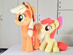 Size: 1024x768 | Tagged: safe, artist:nekokevin, apple bloom, applejack, earth pony, pony, bow, cowboy hat, duo, female, filly, hair bow, hat, irl, mare, photo, plushie, siblings, sisters, sitting, smiling