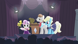 Size: 1280x720 | Tagged: safe, screencap, eclair créme, jangles, star gazer, sweetie belle, earth pony, pony, unicorn, for whom the sweetie belle toils, audience, award, award show, awards, background pony, background pony audience, clothes, curtain, dress, female, filly, hoof hold, lectern, male, mare, microphone, podium, ribbon, spotlight, stage, stallion, trophy, victory