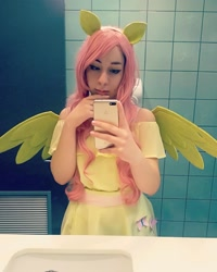 Size: 1014x1268 | Tagged: safe, fluttershy, human, cellphone, clothes, cosplay, costume, cutie mark, cutie mark on clothes, female, irl, irl human, mirror, phone, photo, reflection, selfie, smartphone, spread wings, wings