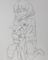 Size: 1080x1350 | Tagged: safe, artist:poorunii, pinkie pie, bipedal, blushing, crossover, frisk, hug, pencil drawing, smiling, traditional art, undertale