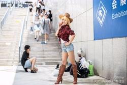 Size: 8256x5504 | Tagged: safe, artist:黑明er, applejack, human, absurd resolution, apple, applejack's hat, boots, clothes, cosplay, costume, cowboy hat, denim shorts, food, hat, irl, irl human, photo, shirt, shoes, shorts