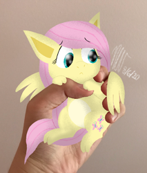 Size: 768x900 | Tagged: safe, artist:flutteryoshi952, fluttershy, pegasus, pony, :<, colored belly, disembodied hand, female, hand, holding a pony, in goliath's palm, irl, looking away, looking down, mare, photo, ponies in real life, solo, spread wings, wings