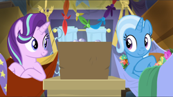 Size: 1666x941 | Tagged: safe, screencap, starlight glimmer, trixie, road to friendship, bed, box, cropped, cute, diatrixes, duo, female, glimmerbetes, looking at each other, lying down, lying on bed, on bed, smiling