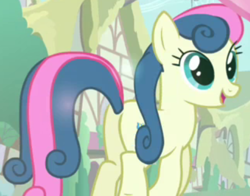 Size: 884x692 | Tagged: safe, screencap, bon bon, sweetie drops, earth pony, pony, a friend in deed, adorabon, amused, background pony, bon bon is amused, butt, cropped, cute, cutie mark, female, mare, open mouth, plot, ponyville, smile song, smiling, solo, solo focus, trotting