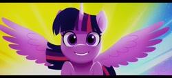 Size: 2400x1080 | Tagged: safe, screencap, twilight sparkle, alicorn, pony, g5, my little pony: a new generation, spoiler:g5, spoiler:my little pony: a new generation, female, grin, lip bite, mare, smiling, solo, spread wings, twilight sparkle (alicorn), wings