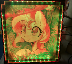 Size: 1024x908 | Tagged: safe, artist:themisto97, sunset shimmer, pony, unicorn, acrylic plastic, acrylight, background pony, bust, craft, cute, daaaaaaaaaaaw, engraving, female, jewelry, jungle, lasercut, led, mare, multicolored, necklace, nightlight, photo, plushie, portrait, shimmerbetes, smiling, solo, sweet dreams fuel