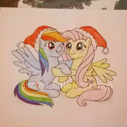 Size: 948x949 | Tagged: safe, artist:mmy_little_drawings, fluttershy, rainbow dash, pegasus, pony, christmas, duo, eyelashes, female, flutterdash, grin, hat, holding hooves, holiday, lesbian, mare, obtrusive watermark, one eye closed, santa hat, shipping, sitting, smiling, traditional art, watermark, wink