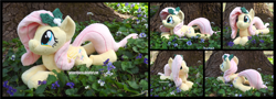 Size: 4890x1754   Tagged: safe, artist:peruserofpieces, fluttershy, pegasus, pony, beanie (plushie), female, flower, holly, irl, lying down, mare, photo, plushie, prone, smiling, sploot, tree, wings