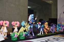 Size: 2560x1707 | Tagged: safe, angel bunny, applejack, fluttershy, princess skystar, rainbow dash, rarity, spike, trixie, dragon, earth pony, hippogriff, pegasus, unicorn, anthro, my little pony: the movie, 2021, applejack's hat, beatnik rarity, beret, clothes, costume, cowboy hat, cutie mark, cyrillic, dress, epaulettes, female, figure, figurine, filly, flying, hat, horn, jewelry, lasso, leggings, necklace, newbronycon, photo, rearing, rope, rubronycon, russian, smiling, socks, spread wings, sundress, sweater, top hat, wand, wings