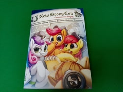Size: 2560x1917   Tagged: safe, artist:zazush-una, apple bloom, featherweight, scootaloo, sweetie belle, twilight sparkle, pony, 2021, bag, blackletter, book, camera, cutie mark crusaders, cyrillic, hat, mouth hold, newbronycon, newspaper, notepad, pencil, rubronycon, russian, saddle bag