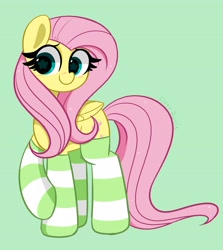 Size: 3110x3494 | Tagged: safe, artist:kittyrosie, fluttershy, pegasus, pony, blushing, clothes, cute, daaaaaaaaaaaw, female, green background, mare, redraw, shyabetes, simple background, socks, solo, striped socks, wingding eyes